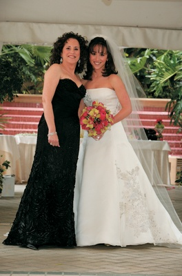 Bride with mother of bride in strapless black gown