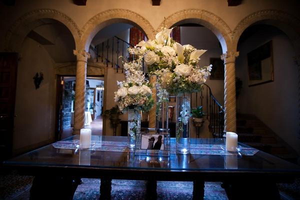 White flower arrangement at wedding reception entrance