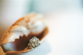 Platinum engagement ring inside seashell