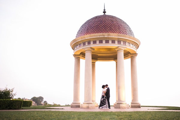 the resort at pelican hill wedding, couple in black and white beneath rotunda at pelican hill