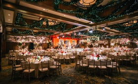 wedding reception ballroom holiday christmas theme red white greenery ballroom decor