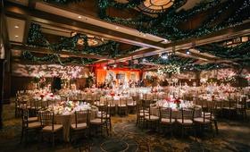wedding reception ballroom holiday christmas theme red white greenery ballroom decor