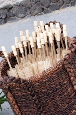 Rice paper parasol shades in wicker basket