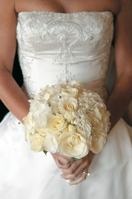 Bridal bouquet with stephanotis and rose blossoms and jewels