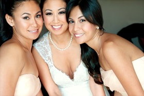 Bride with two bridesmaids in strapless spring dresses
