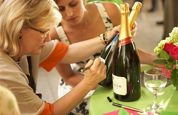 Friends and family sign champagne