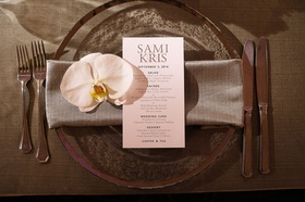 Wedding reception translucent charger plate silver rim with grey napkin simple menu and white orchid