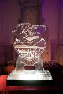 Ice luge with couple's names and heart-shaped sketch