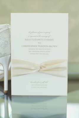 Simple invite with ivory ribbon and gold lettering