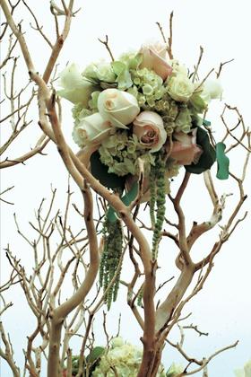 Rose, hydrangea, and amaranth on tan tree