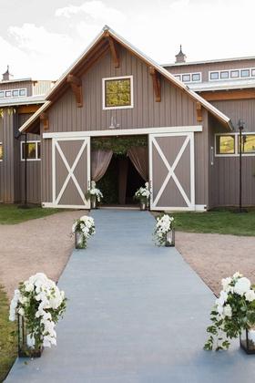 Aspen Colorado wedding reception barn wedding venue lantern orchid greenery decor outside