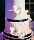 pink ombre cake with navy ribbon, gum paste flowers luster dust, dots, touch of gold