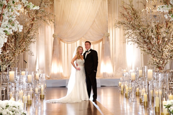 Glamorous ivory blush spring wedding at a private club in chicago bride in a strapless pnina tornai dress groom in a black tuxedo at jewish wedding junglespirit