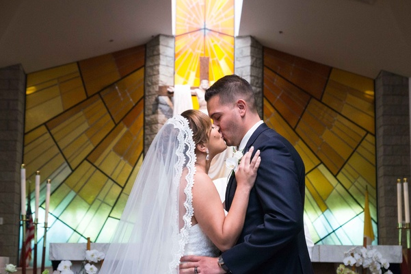 bride groom first kiss catholic church walnut california long veil stained glass