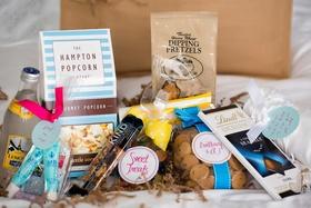 gift gourmet popcorn, lemonade, kind bars, Lindt chocolates, dipping pretzels, cookies, gummy bears