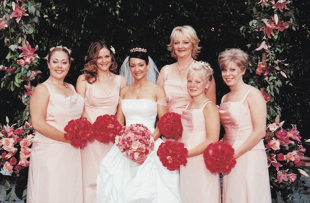 Bride with five bridesmaids in pink bridesmaid dresses