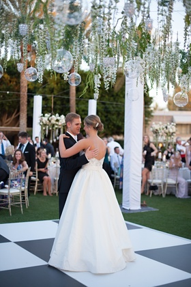 Bride in a strapless Anne Barge dress dances with groom in tuxedo, Arizona Biltmore