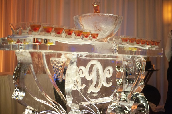 Ice sculpture bar with ice bucket and wedding monogram