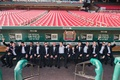 Groom with groomsmen and ring bearers in dugout at Busch Stadium in St. Louis Missouri baseball MLB