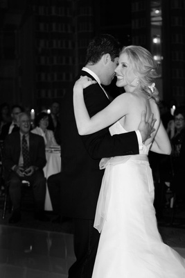 Black and white photo of bride and groom ballroom dancing