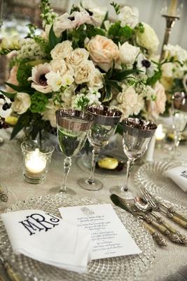 wedding reception place setting crystal charger monogram napkin menu card anemone rose centerpiece