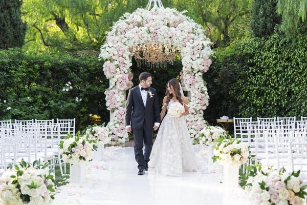 bride in galia lahav wedding dress groom in tux white pink flower chuppah beverly hills hotel