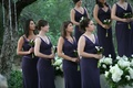 Bridesmaids in plum gowns at ceremony