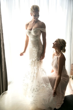 Actress brittany daniel in off shoulder form fitting wedding dress with sister cynthia daniel