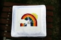 Rainbow design on stitched ring pillow for wedding