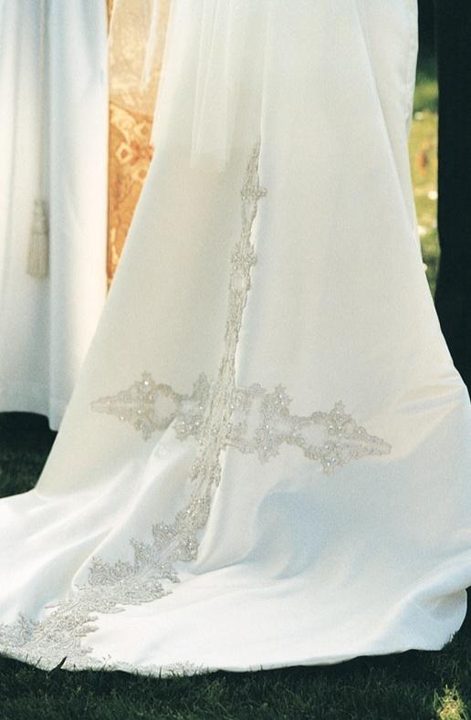 Cross embellishments on white wedding dress
