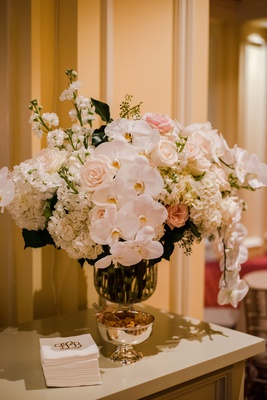 wedding reception flower arrangement white phalaenopsis orchid white hydrangea pink rose stock