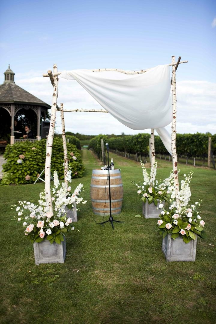 Birch poles and rustic pots filled with flowers