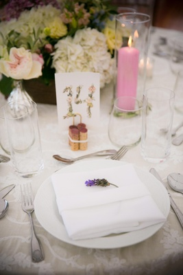 sprig of lavender at place setting for wedding pink candle flower print table number