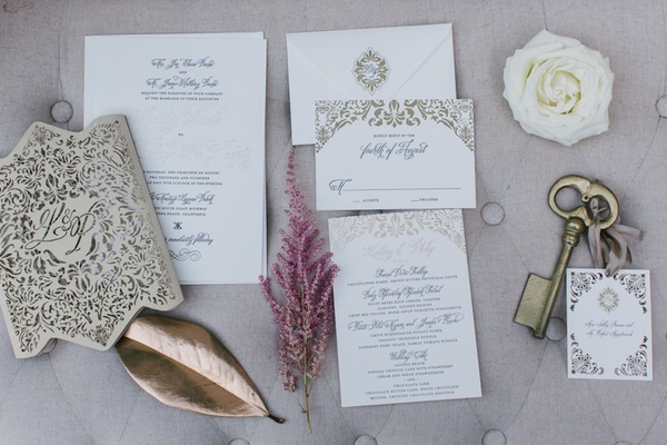Ceci New York wedding invitation suite with golden damask embellishments