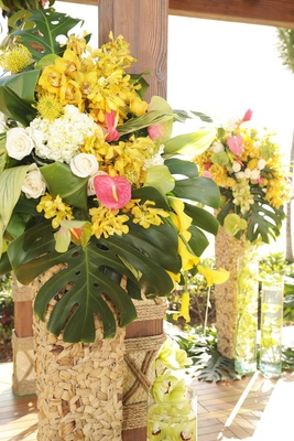Jungle leaves and flowers in tall baskets