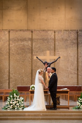 Bride and groom at wedding ceremony in the Cathedral of Our Lady of the Angels