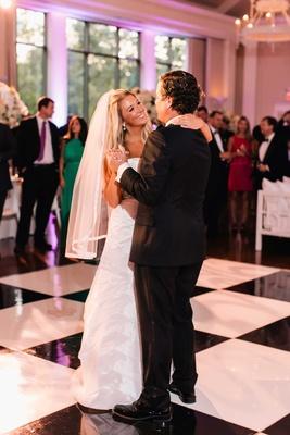 Bride in Anne Barge wedding dress fingertip veil with black and white checker dance floor