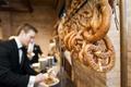 wedding reception food station pretzels hanging