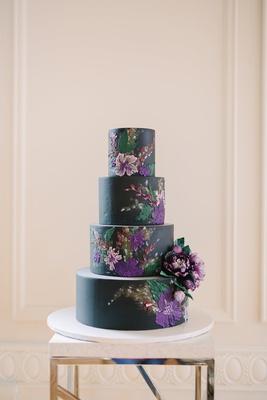black wedding cake with purple flower details