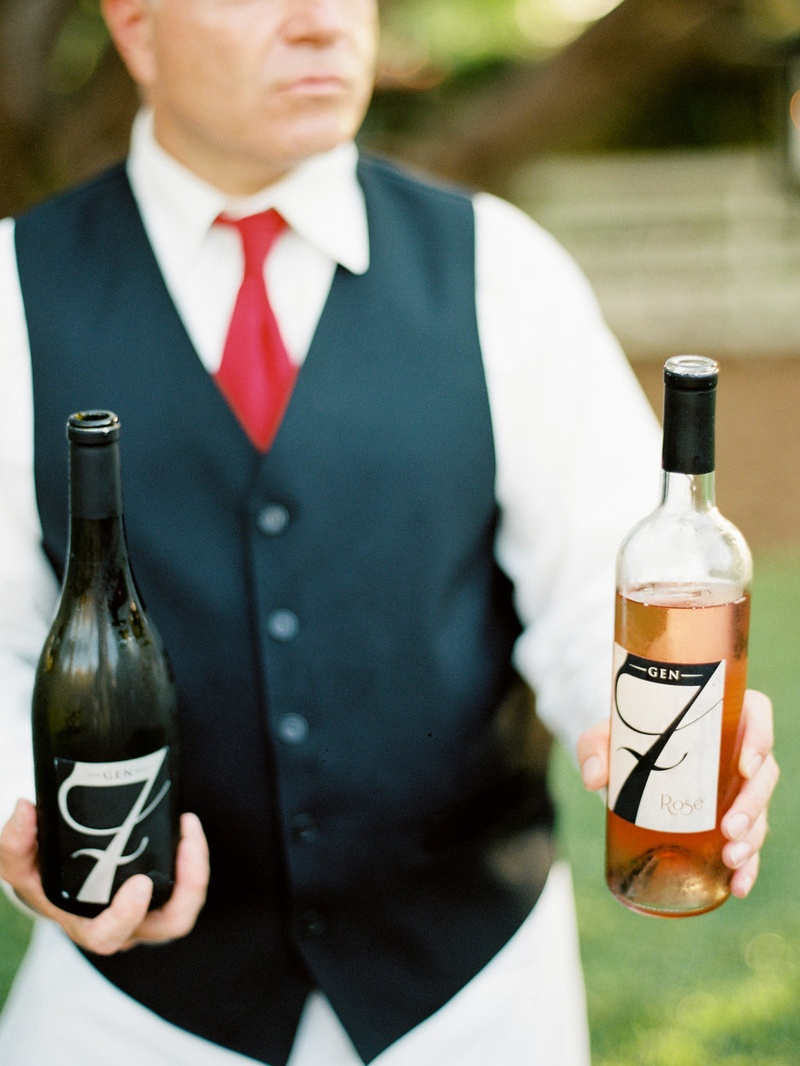 Gen7 Rose and wine in bottles held by wedding catering server