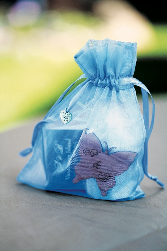 Welcome bag for wedding guest in blue and full of goodies
