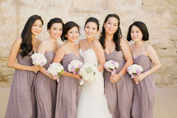 bride in romona keveza strapless wedding dress, bridesmaids in mauve chiffon strapless dresses