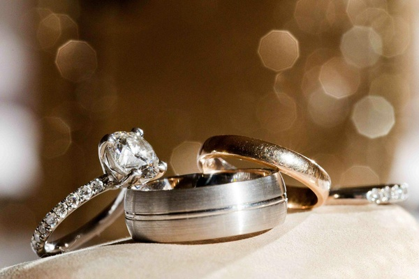 Diamond band engagement ring and grooved men's band
