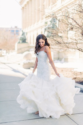 brooke squires in mermaid wedding dress allure bridals ruffle skirt long hair worn down curls