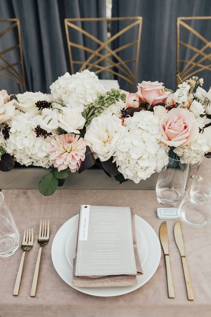 wedding reception place setting gold flatware flower box white hydrangea pink rose dahlia burgundy