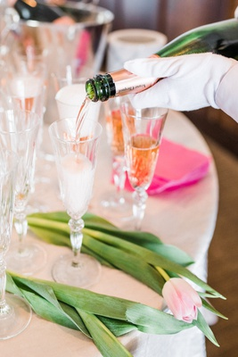 white glove service poured champagne for guests at bridal shower