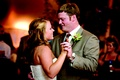Bride in a strapless Vera Wang gown dances with groom in a tan suit