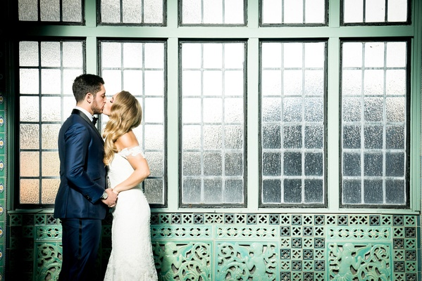 Bride and groom kiss anne barge wedding dress pleasantdale chateau in new jersey wedding portrait