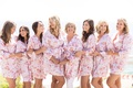 bride, mother of the bride, bridesmaids getting ready in long-sleeve pink floral robe