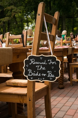 Chalkboard sign at bridal shower reserved for bride to be